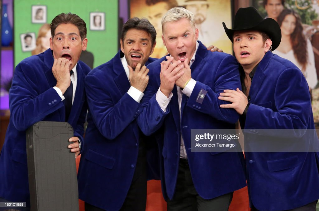 Johnny Lozada, Eugenio Derbez, Sam Champion and El Dasa are seen on the set of Despierta America for simulcast with 'Good Morning America' and Fusion's the Morning Show' at Univision Headquarters on October 28, 2013 in Miami, Florida.