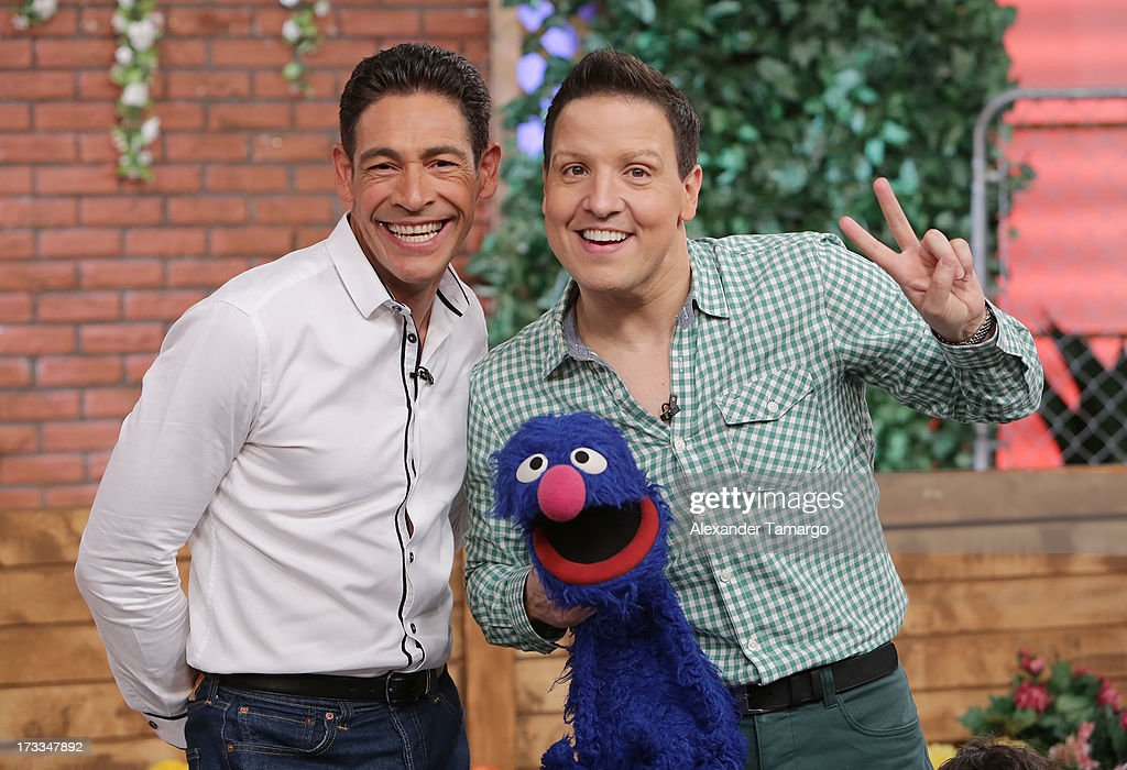 Johnny Lozada, Grover and Raul Gonzalez are seen during Sesame Street's visit of Univision's 'Despierta America' at Univision Headquarters on July 12, 2013 in Miami, Florida.