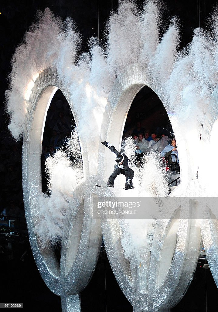 Johnny Lyall, 23, Canadian snowboarder, jumps through the Olympics rings during the opening ceremony of the Vancouver 2010 Winter Olympics at BC place on February 12, 2010 in Vancouver.