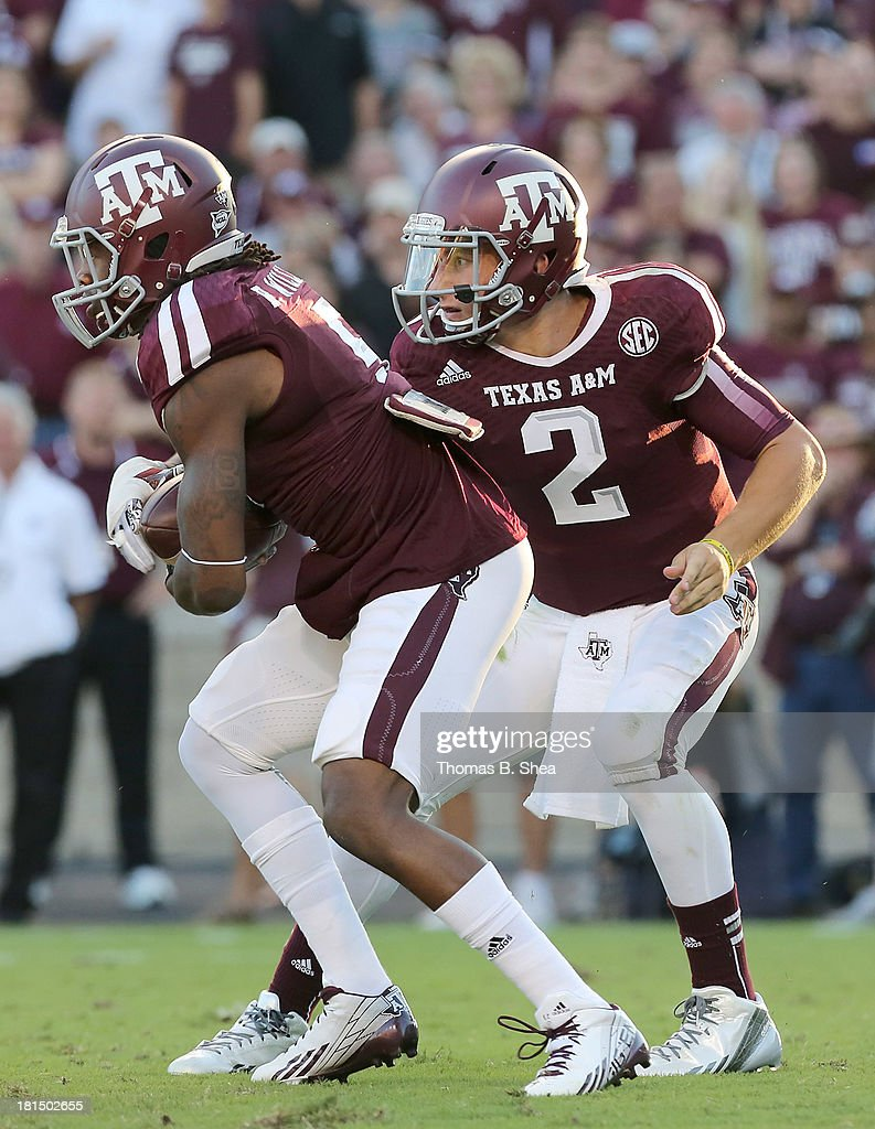 <a gi-track='captionPersonalityLinkClicked' href=/galleries/search?phrase=Johnny+Manziel&family=editorial&specificpeople=9703372 ng-click='$event.stopPropagation()'>Johnny Manziel</a> #2 hands the ball off to Brandon Williams #5 of the Texas A&M Aggies against Southern Methodist Mustangs in the second half on September 21, 2013 at Kyle Field in College Station, Texas.
