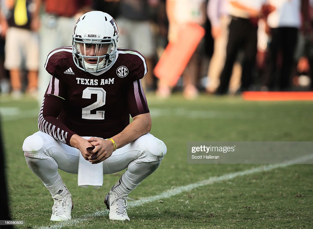 <a gi-track='captionPersonalityLinkClicked' href=/galleries/search?phrase=Johnny+Manziel&family=editorial&specificpeople=9703372 ng-click='$event.stopPropagation()'>Johnny Manziel</a> #2 of Texas A&M Aggies reacts to a play in the fourth quarter during the game against the Alabama Crimson Tide at Kyle Field on September 14, 2013 in College Station, Texas.