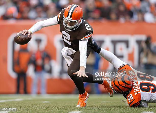 Johnny Manziel of the Cleveland Browns avoids a tackle by Brandon Thompson of the Cincinnati Bengals during the third quarter at FirstEnergy Stadium...