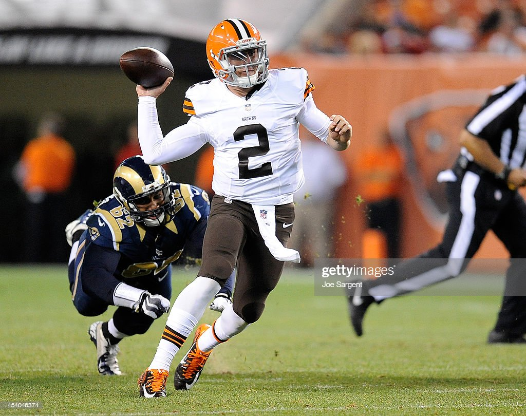 Johnny Manziel #2 of the Cleveland Browns avoids a tackle by Ethan Westbrooks #62 of the St. Louis Rams at FirstEnergy Stadium on August 23, 2014 in Cleveland, Ohio.