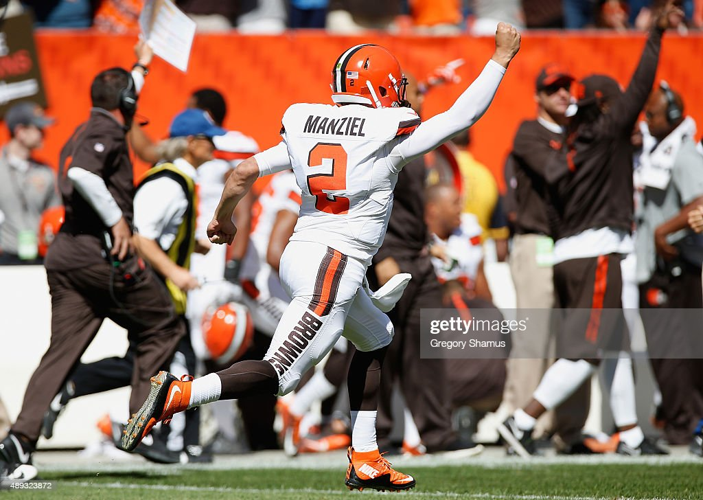 Johnny Manziel of the Cleveland Browns celebrates a first quarter touchdown pass while playing the Tennessee Titans at FirstEnergy Stadium on...
