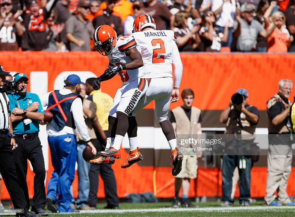 Johnny Manziel of the Cleveland Browns celebrates a first quarter touchdown pass with Andrew Hawkins while playing the Tennessee Titans at...