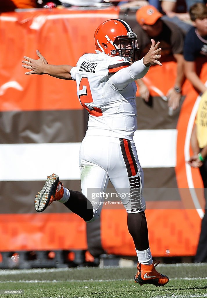 Johnny Manziel of the Cleveland Browns celebrates a fourth quarter touchdown pass while playing the Tennessee Titans at FirstEnergy Stadium on...