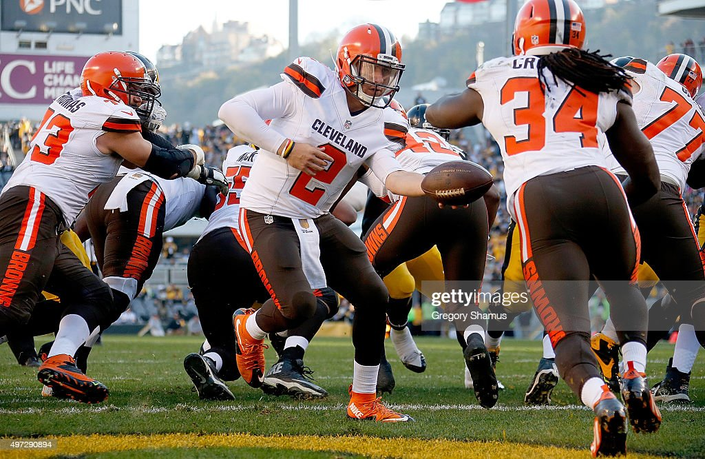 Johnny Manziel of the Cleveland Browns hands the ball off to Isaiah Crowell during the 2nd quarter of the game against the Pittsburgh Steelers at...