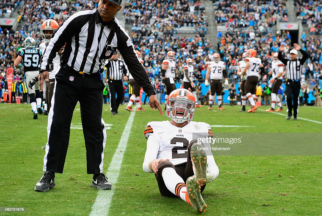 <a gi-track='captionPersonalityLinkClicked' href=/galleries/search?phrase=Johnny+Manziel&family=editorial&specificpeople=9703372 ng-click='$event.stopPropagation()'>Johnny Manziel</a> #2 of the Cleveland Browns reacts after being hit by Luke Kuechly #59 of the Carolina Panthers during their game at Bank of America Stadium on December 21, 2014 in Charlotte, North Carolina.