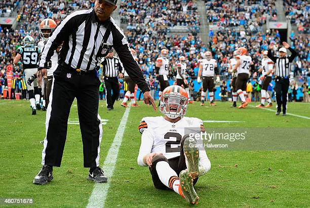 Johnny Manziel of the Cleveland Browns reacts after being hit by Luke Kuechly of the Carolina Panthers during their game at Bank of America Stadium...