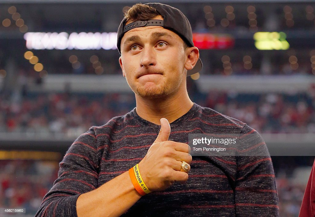 Johnny Manziel of the Cleveland Browns reacts after receiving his Aggie Ring during half time of the Southwest Classic at ATT Stadium on September 27...