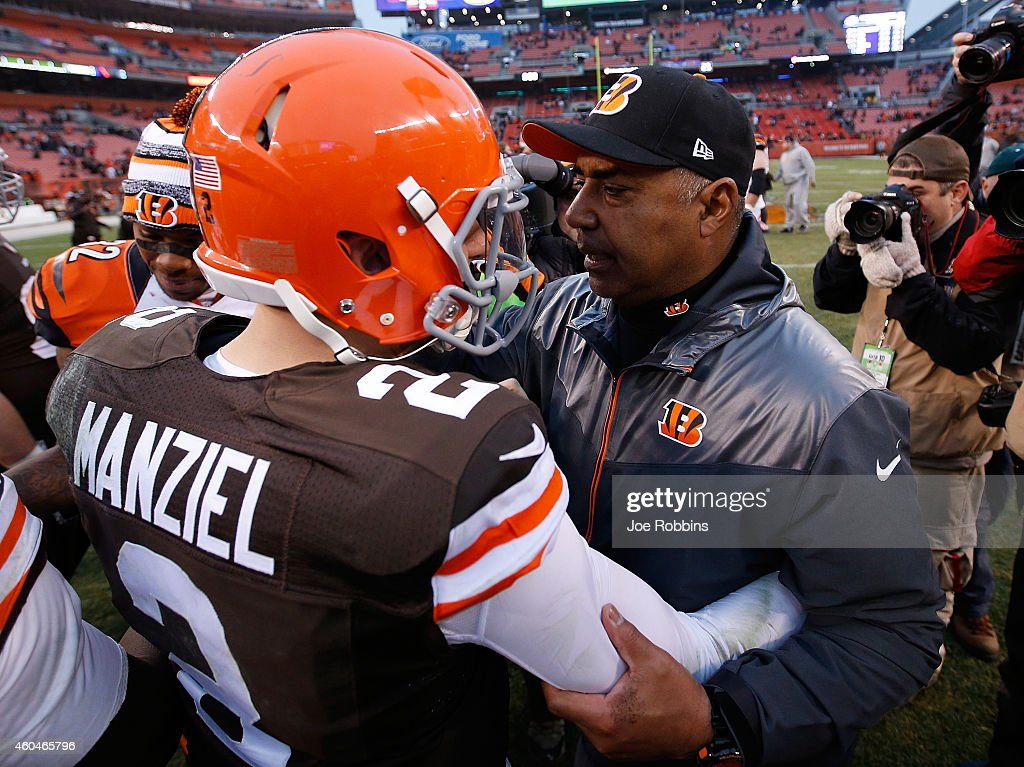<a gi-track='captionPersonalityLinkClicked' href=/galleries/search?phrase=Johnny+Manziel&family=editorial&specificpeople=9703372 ng-click='$event.stopPropagation()'>Johnny Manziel</a> #2 of the Cleveland Browns talks with head coach <a gi-track='captionPersonalityLinkClicked' href=/galleries/search?phrase=Marvin+Lewis+-+Coach&family=editorial&specificpeople=211207 ng-click='$event.stopPropagation()'>Marvin Lewis</a> of the Cincinnati Bengals after Cincinnati's 30-0 win at FirstEnergy Stadium on December 14, 2014 in Cleveland, Ohio.