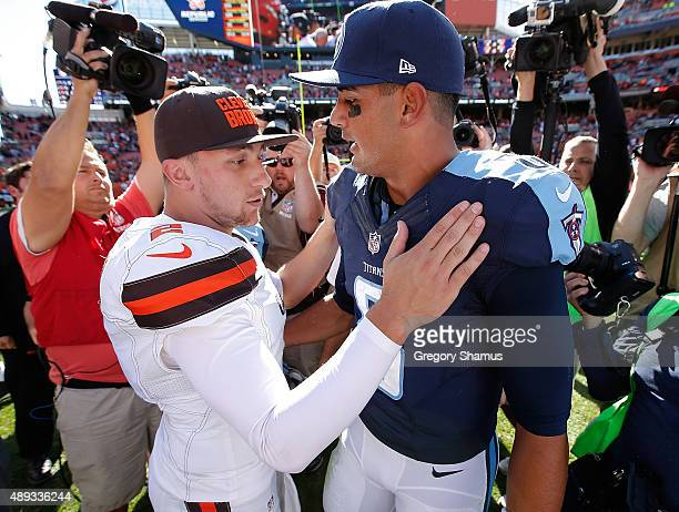 Johnny Manziel of the Cleveland Browns talks with Marcus Mariota of the Tennessee Titans after a 2814 Cleveland win at FirstEnergy Stadium on...