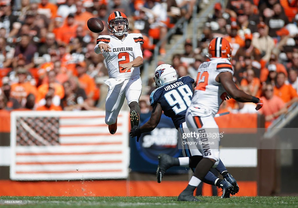 Johnny Manziel of the Cleveland Browns throws a second quarter pass behind the defense of Brian Orakpo of the Tennessee Titans at FirstEnergy Stadium...