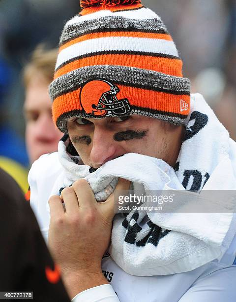 Johnny Manziel of the Cleveland Browns watches play from the sideline after being injured against the Carolina Panthers on December 21 2014 at Bank...