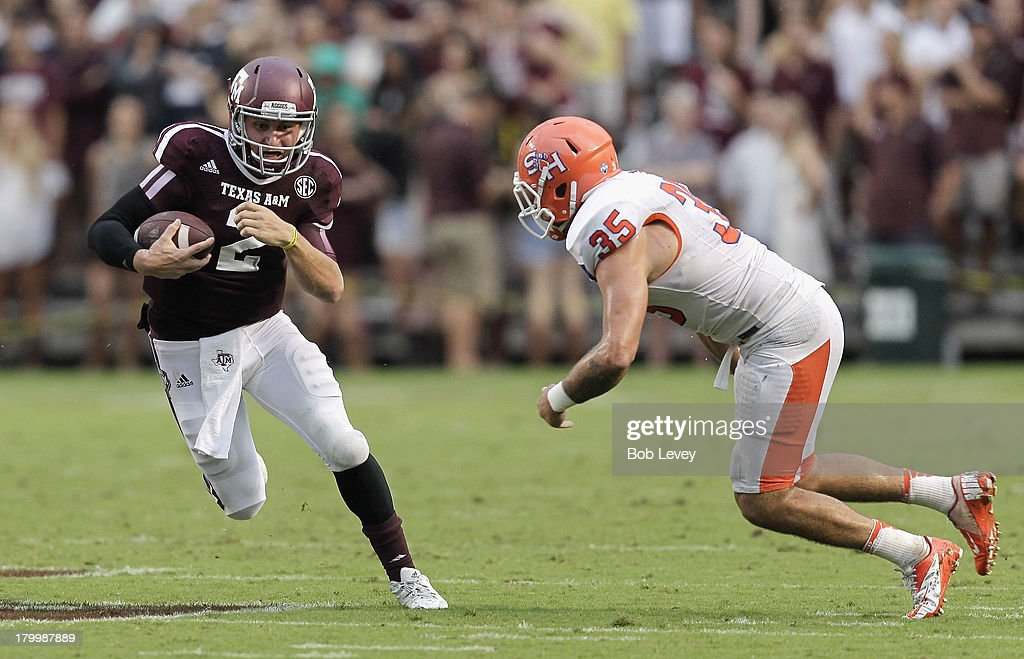 Johnny Manziel #2 of the Texas A&M Aggies avoids being tackled by Tanner Brock #35 of the Sam Houston State Bearkats in the second quarter at Kyle Field on September 7, 2013 in College Station, Texas.