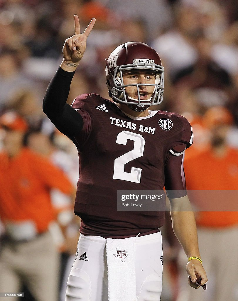 <a gi-track='captionPersonalityLinkClicked' href=/galleries/search?phrase=Johnny+Manziel&family=editorial&specificpeople=9703372 ng-click='$event.stopPropagation()'>Johnny Manziel</a> #2 of the Texas A&M Aggies calls out a play in the third quarter against the Sam Houston State Bearkats at Kyle Field on September 7, 2013 in College Station, Texas.