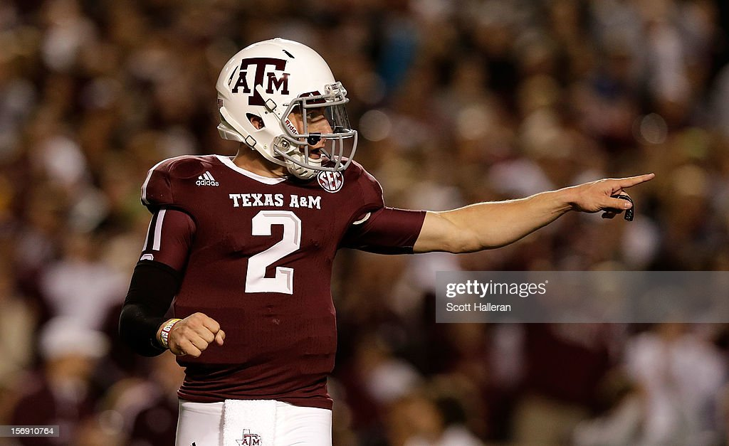 Johnny Manziel #2 of the Texas A&M Aggies celebrates a first quarter touch down during their game against the Missouri Tigers at Kyle Field on November 24, 2012 in College Station, Texas.