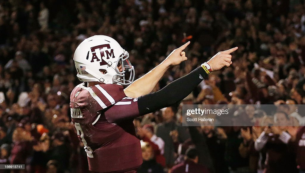 Johnny Manziel #2 of the Texas A&M Aggies celebrates a third quarter touchdown during their game against the Missouri Tigers at Kyle Field on November 24, 2012 in College Station, Texas.