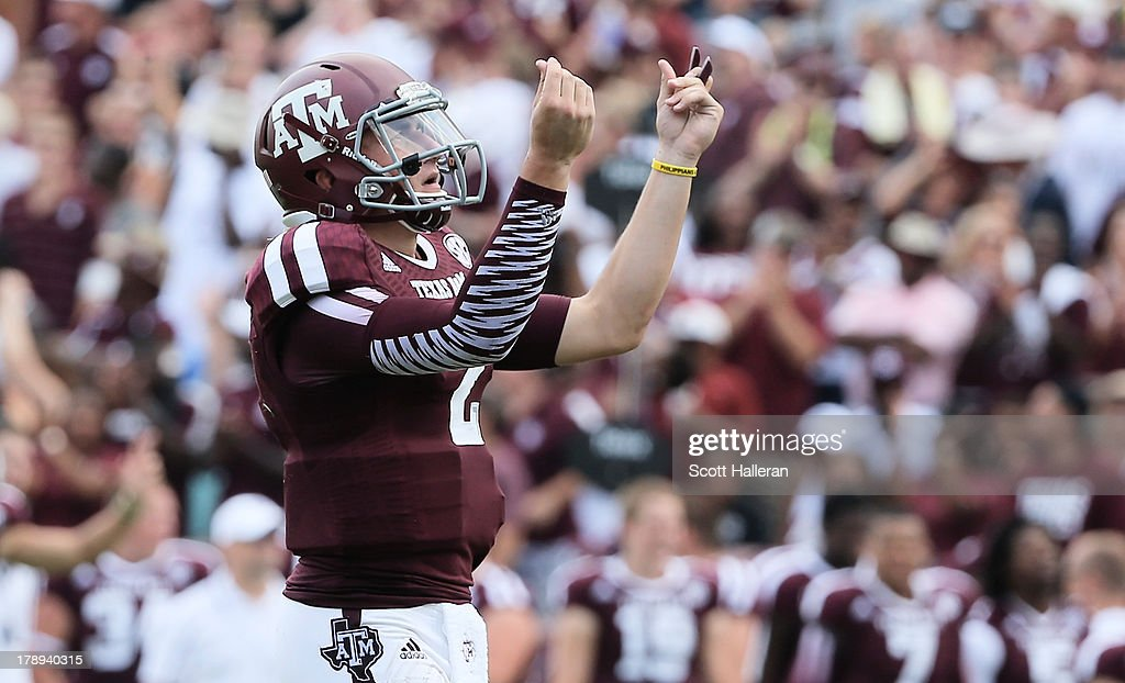 Johnny Manziel of the Texas AM Aggies celebrates a third quarter touchdown during the game against the Rice Owls at Kyle Field on August 31 2013 in...