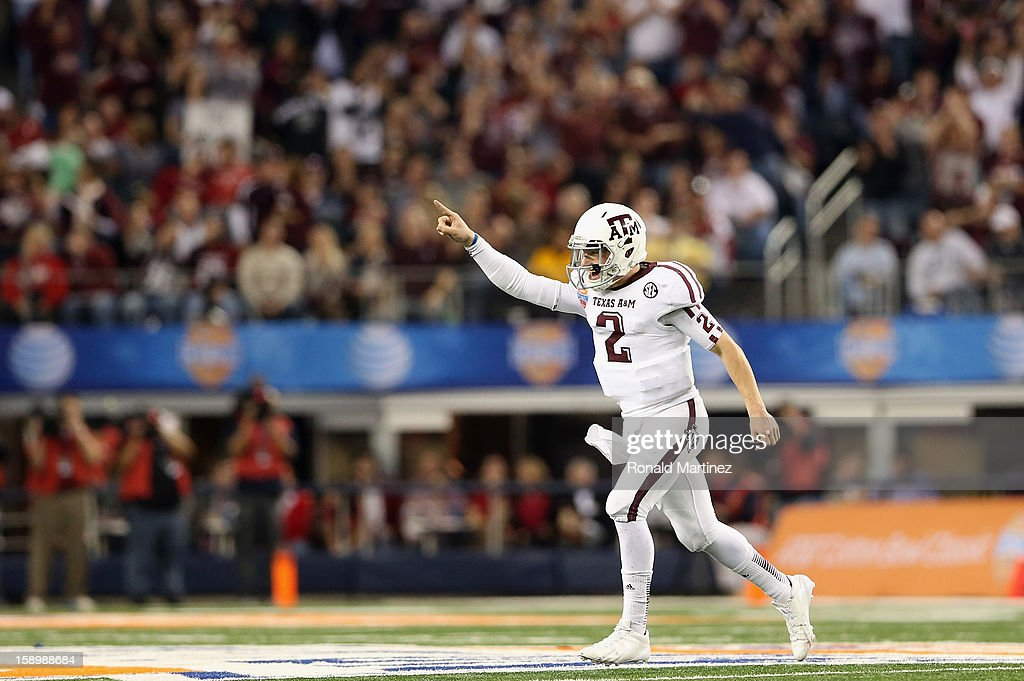 Johnny Manziel #2 of the Texas A&M Aggies celebrates a touchdown against the Oklahoma Sooners during the Cotton Bowl at Cowboys Stadium on January 4, 2013 in Arlington, Texas.