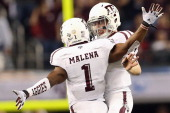 Johnny Manziel of the Texas AM Aggies celebrates a touchdown with Ben Malena against the Oklahoma Sooners during the Cotton Bowl at Cowboys Stadium...