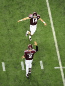 Johnny Manziel of the Texas AM Aggies celebrates with Conner McQueen after throwing a touchdown pass against the Duke Blue Devils during the...