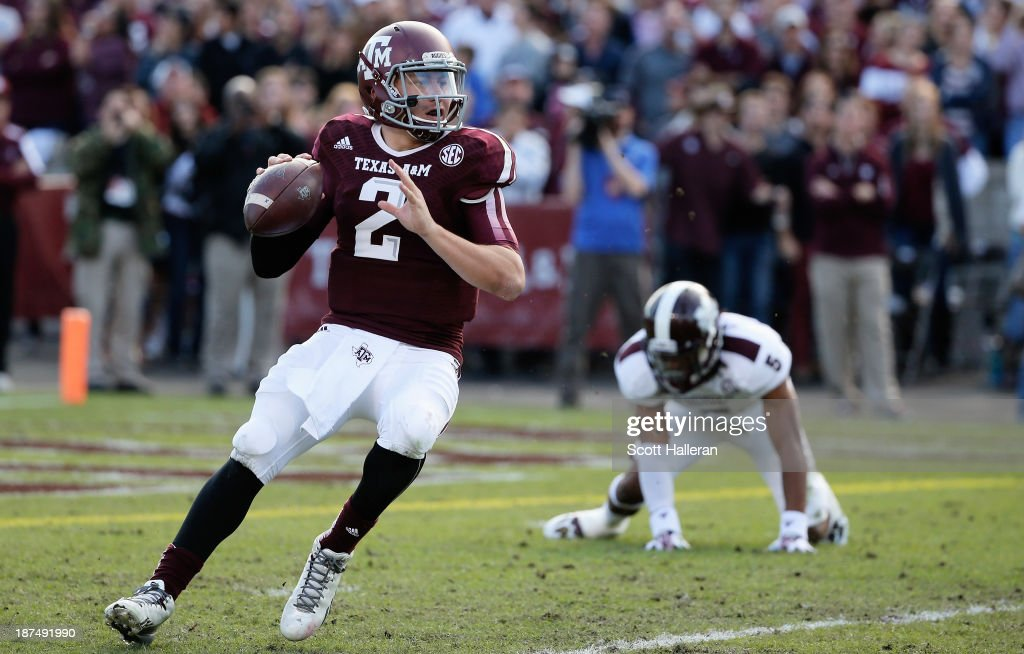 Johnny Manziel of the Texas AM Aggies drops back to pass in the first half during the game against the Mississippi State Bulldogs at Kyle Field on...