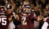 Johnny Manziel of the Texas AM Aggies drops back to pass in the second half during the game against the Mississippi State Bulldogs at Kyle Field on...