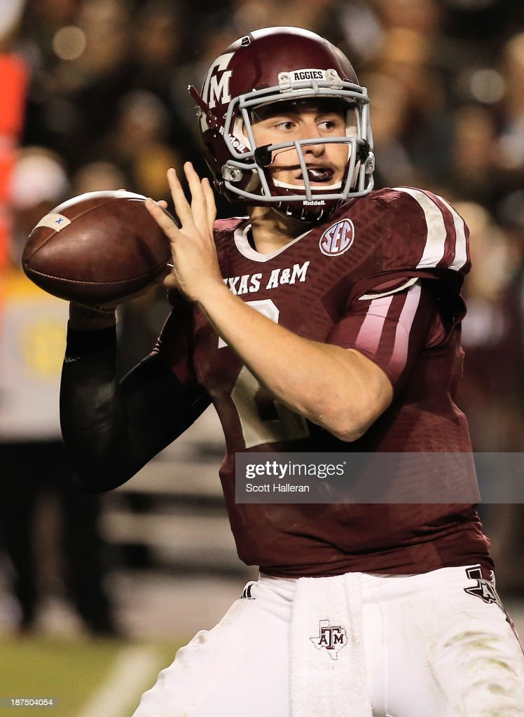 Johnny Manziel of the Texas AM Aggies drops back to pass in the fourth quarter during the game against the Mississippi State Bulldogs at Kyle Field...