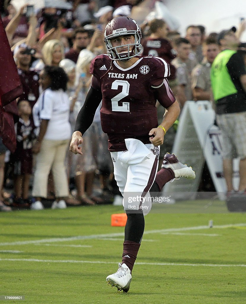 <a gi-track='captionPersonalityLinkClicked' href=/galleries/search?phrase=Johnny+Manziel&family=editorial&specificpeople=9703372 ng-click='$event.stopPropagation()'>Johnny Manziel</a> #2 of the Texas A&M Aggies leads his team onto the field against the Sam Houston State Bearkats at Kyle Field on September 7, 2013 in College Station, Texas.