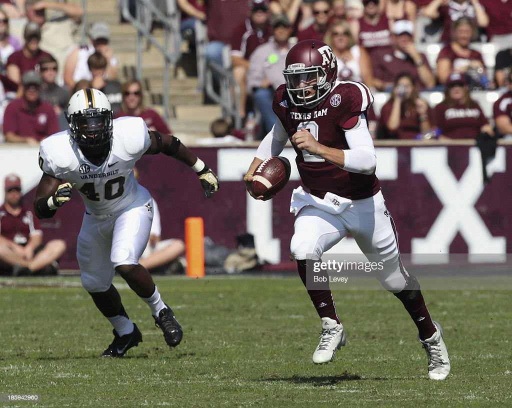 Johnny Manziel #2 of the Texas A&M Aggies looks for a receicver as he scrambles to avoid Ja'karri Thomas #40 of the Vanderbilt Commodores at Kyle Field on October 26, 2013 in College Station, Texas.