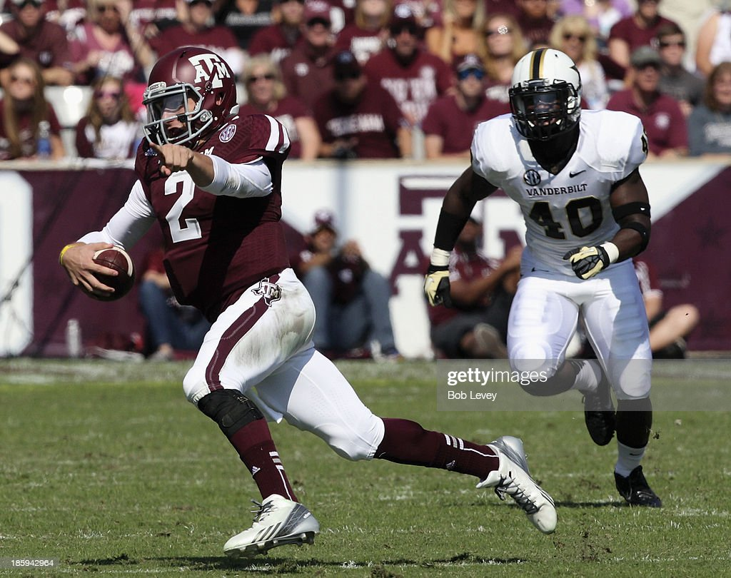 <a gi-track='captionPersonalityLinkClicked' href=/galleries/search?phrase=Johnny+Manziel&family=editorial&specificpeople=9703372 ng-click='$event.stopPropagation()'>Johnny Manziel</a> #2 of the Texas A&M Aggies looks for a receicver as he scrambles to avoid Ja'karri Thomas #40 of the Vanderbilt Commodores at Kyle Field on October 26, 2013 in College Station, Texas.