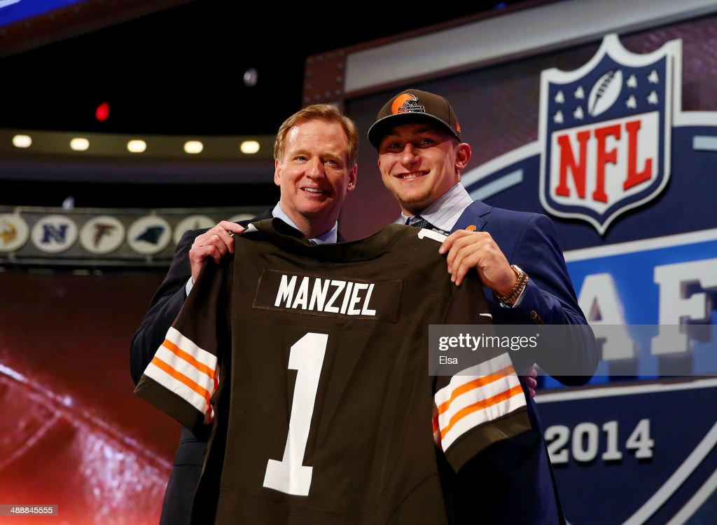 <a gi-track='captionPersonalityLinkClicked' href=/galleries/search?phrase=Johnny+Manziel&family=editorial&specificpeople=9703372 ng-click='$event.stopPropagation()'>Johnny Manziel</a> of the Texas A&M Aggies poses with NFL Commissioner <a gi-track='captionPersonalityLinkClicked' href=/galleries/search?phrase=Roger+Goodell&family=editorial&specificpeople=744758 ng-click='$event.stopPropagation()'>Roger Goodell</a> after he was picked #22 overall by the Cleveland Browns during the first round of the 2014 NFL Draft at Radio City Music Hall on May 8, 2014 in New York City.