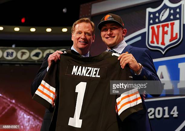 Johnny Manziel of the Texas AM Aggies poses with NFL Commissioner Roger Goodell after he was picked overall by the Cleveland Browns during the first...