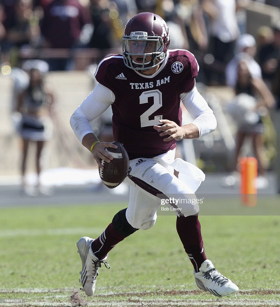 <a gi-track='captionPersonalityLinkClicked' href=/galleries/search?phrase=Johnny+Manziel&family=editorial&specificpeople=9703372 ng-click='$event.stopPropagation()'>Johnny Manziel</a> #2 of the Texas A&M Aggies rolls out looking for a receiver against the Vanderbilt Commodores at the end of the second quarter at Kyle Field on October 26, 2013 in College Station, Texas.