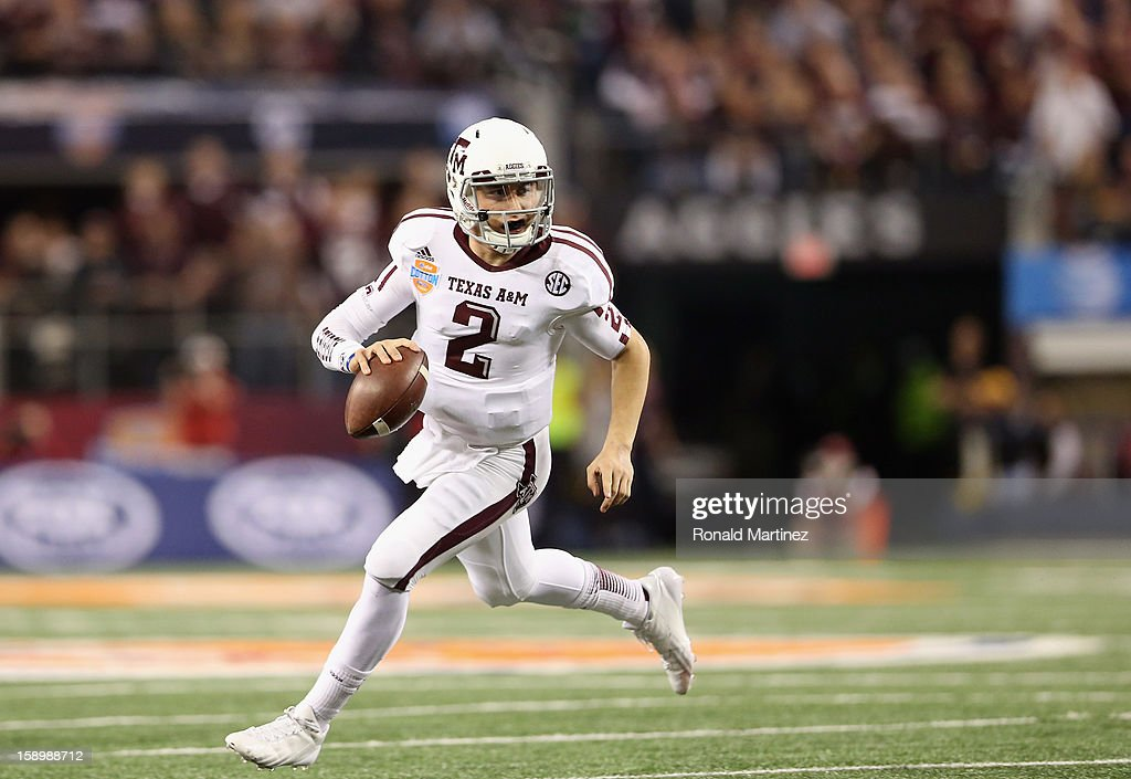 <a gi-track='captionPersonalityLinkClicked' href=/galleries/search?phrase=Johnny+Manziel&family=editorial&specificpeople=9703372 ng-click='$event.stopPropagation()'>Johnny Manziel</a> #2 of the Texas A&M Aggies runs the ball against the Oklahoma Sooners during the Cotton Bowl at Cowboys Stadium on January 4, 2013 in Arlington, Texas.