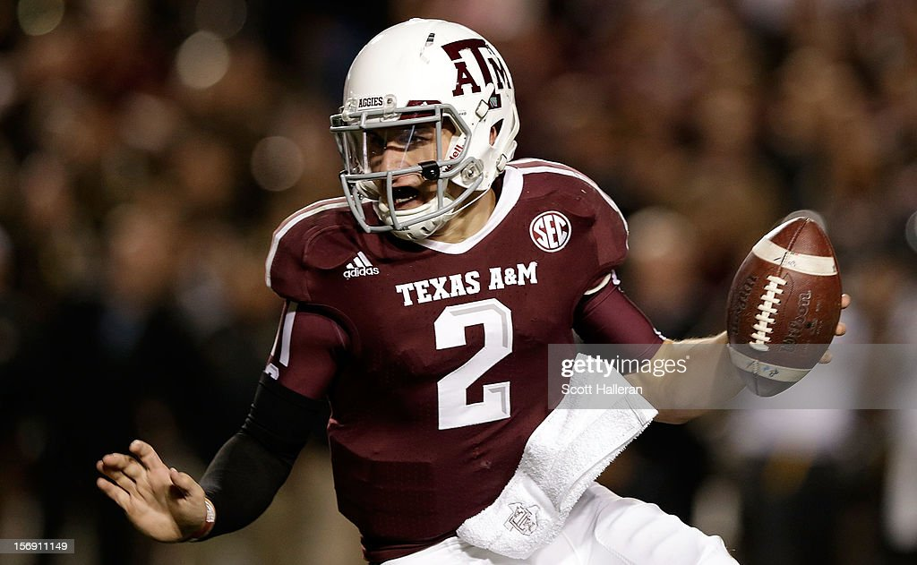 Johnny Manziel of the Texas AM Aggies runs upfield during their game against the Missouri Tigers at Kyle Field on November 24 2012 in College Station...