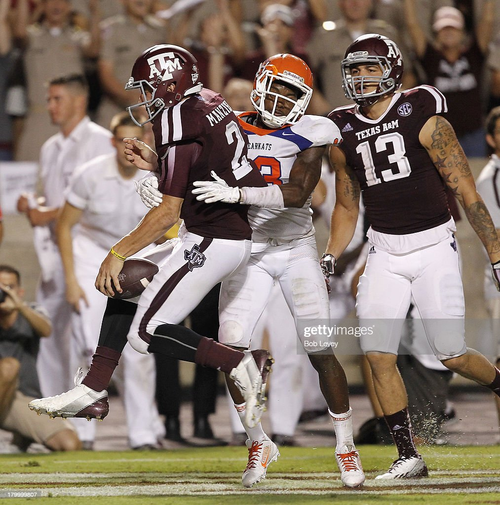 <a gi-track='captionPersonalityLinkClicked' href=/galleries/search?phrase=Johnny+Manziel&family=editorial&specificpeople=9703372 ng-click='$event.stopPropagation()'>Johnny Manziel</a> #2 of the Texas A&M Aggies scores on a six yard run in the third quarter against the Sam Houston State Bearkats at Kyle Field on September 7, 2013 in College Station, Texas.