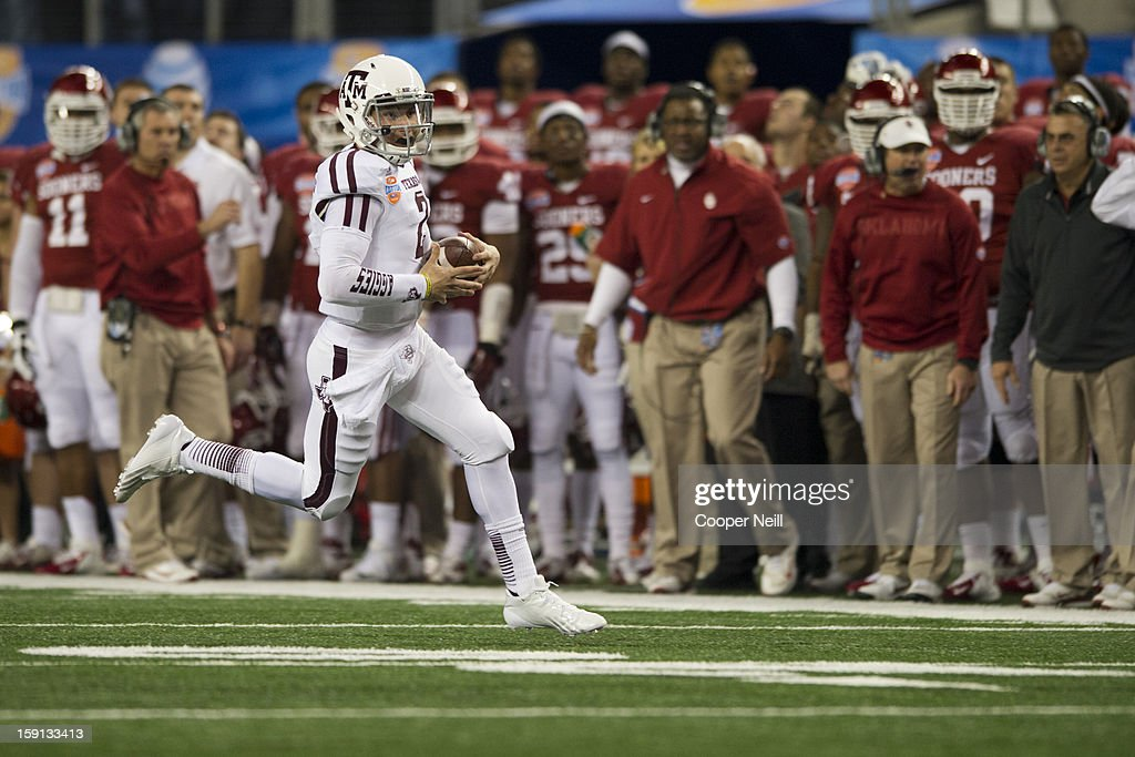Johnny Manziel #2 of the Texas A&M Aggies scrambles for a touchdown against the Oklahoma Sooners during the AT&T Cotton Bowl on January 4, 2013 at Cowboys Stadium in Arlington, Texas.