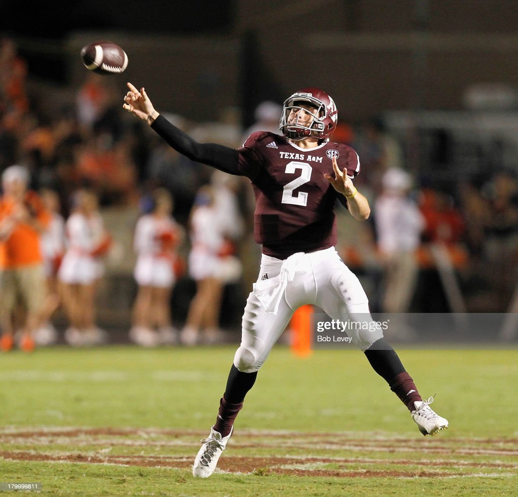 <a gi-track='captionPersonalityLinkClicked' href=/galleries/search?phrase=Johnny+Manziel&family=editorial&specificpeople=9703372 ng-click='$event.stopPropagation()'>Johnny Manziel</a> #2 of the Texas A&M Aggies throws back across the field in hte third quarter against the Sam Houston State Bearkats at Kyle Field on September 7, 2013 in College Station, Texas.