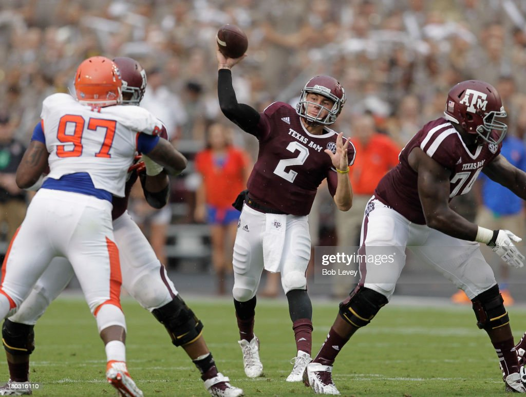<a gi-track='captionPersonalityLinkClicked' href=/galleries/search?phrase=Johnny+Manziel&family=editorial&specificpeople=9703372 ng-click='$event.stopPropagation()'>Johnny Manziel</a> #2 of the Texas A&M Aggies throws deep over <a gi-track='captionPersonalityLinkClicked' href=/galleries/search?phrase=Jarrett+Brown&family=editorial&specificpeople=4056499 ng-click='$event.stopPropagation()'>Jarrett Brown</a> #97 of the Sam Houston State Bearkats at Kyle Field on September 7, 2013 in College Station, Texas.