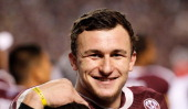 Johnny Manziel of the Texas AM Aggies waits near the bench late in the fourth quarter during the game against the Mississippi State Bulldogs at Kyle...