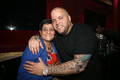 Johnny Marines poses with his mom at the Bar Code Grand Opening Hosted By Romeo Santos And Johnny Marines at Bar Code on May 26 2016 in Elizabeth New...