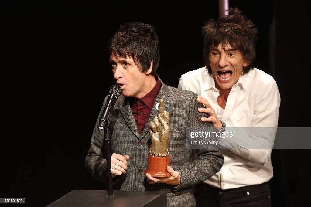 <a gi-track='captionPersonalityLinkClicked' href=/galleries/search?phrase=Johnny+Marr&family=editorial&specificpeople=3947211 ng-click='$event.stopPropagation()'>Johnny Marr</a> is presented the Godlike Genius award by Ronnie Wood at the NME Awards 2013 at the Troxy on February 27, 2013 in London, England.