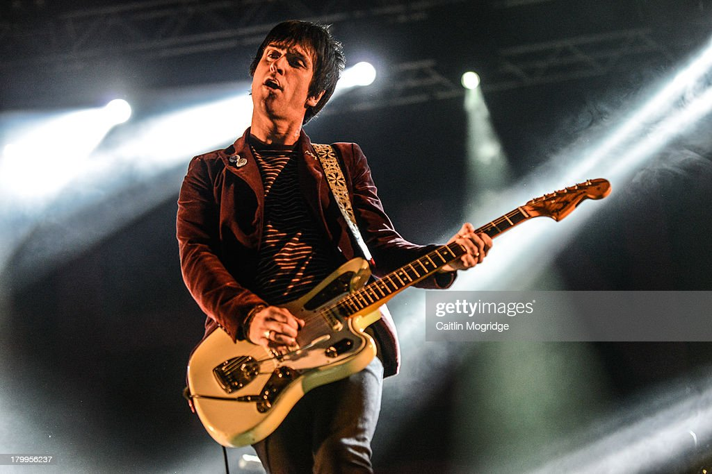 <a gi-track='captionPersonalityLinkClicked' href=/galleries/search?phrase=Johnny+Marr&family=editorial&specificpeople=3947211 ng-click='$event.stopPropagation()'>Johnny Marr</a> performs at Day 3 of Bestival at Robin Hill Country Park on September 7, 2013 in Newport, Isle of Wight