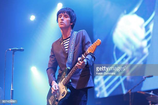 Johnny Marr performs on stage at City Live Manchester City Football Club's Season Launch Party at Manchester Central on 14th August 2014 He is...