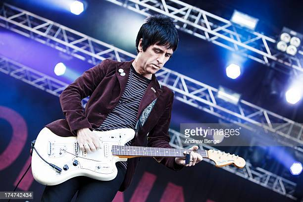 Johnny Marr performs on stage on Day 3 of Kendal Calling Festival at Lowther Deer Park on July 28 2013 in Kendal England