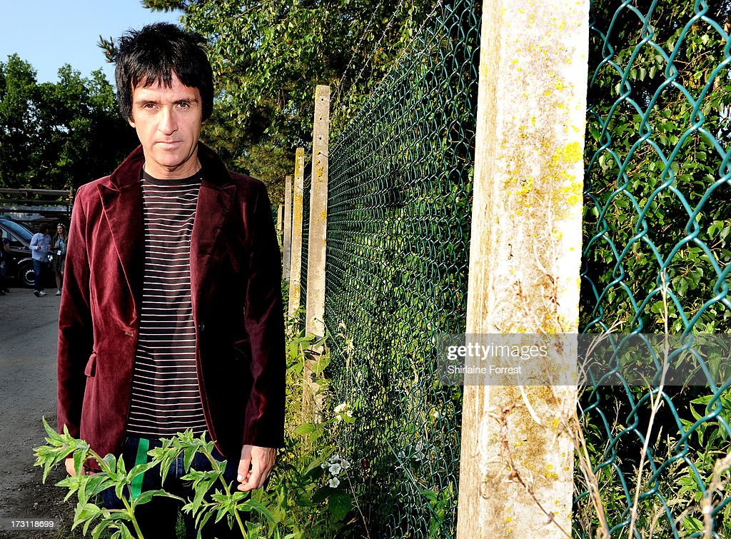 Johnny Marr poses backstage before performing at Jodrell Bank on July 7, 2013 in Manchester, England.