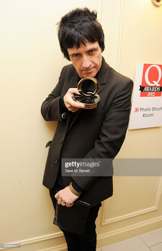 Johnny Marr poses in the press room at The Q Awards 2012 at the Grosvenor House Hotel on October 22 2012 in London England