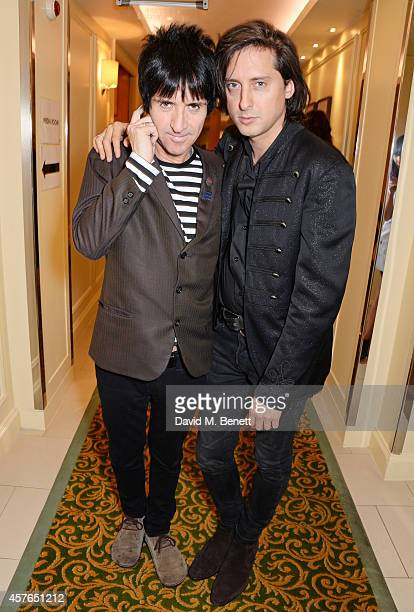 Johnny Marr winner of the Gibson Les Paul award and Carl Barat pose in the press room at the Xperia Access Q Awards at The Grosvenor House Hotel on...